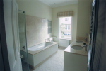 Built in bath with stone surround