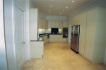 Contemporary kitchen with USA type fridge freezer